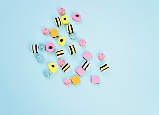 Colored chewing sweets on the blue background