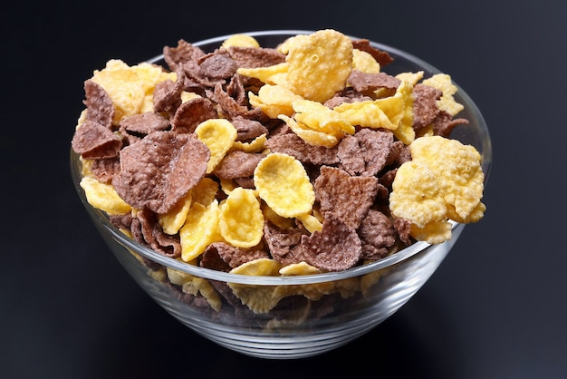 Colored corn flakes in a bowl . useful vitamin food