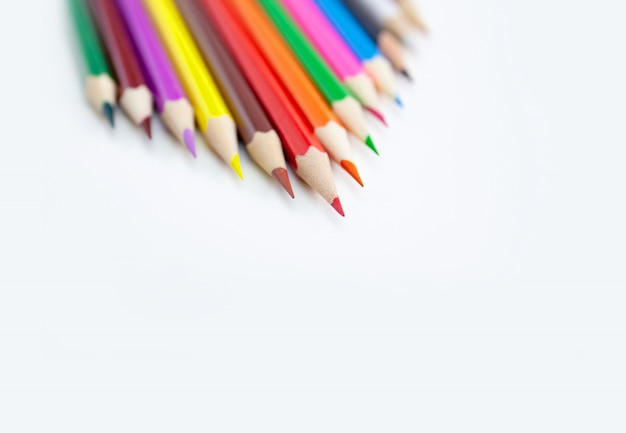 Colored crayon pencils isolated on white background.