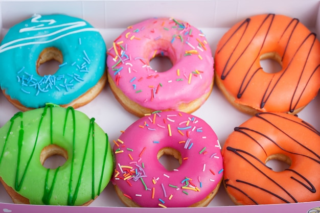 Colored donuts with glaze.