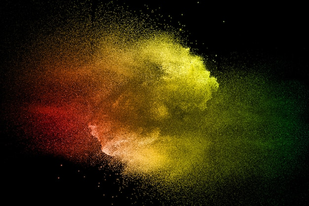Colored dust splash cloud  on dark background. launched colorful particles on background.