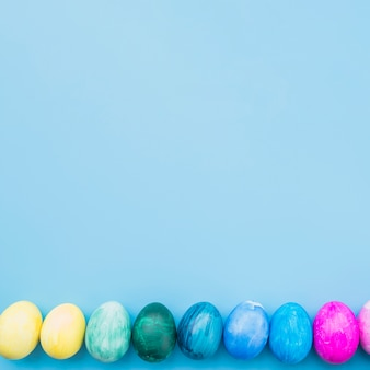 Colored eggs on blue background