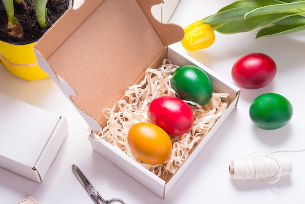 Colored eggs inside of cardboard box