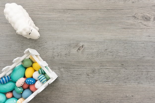 Colored eggs and sheep for easter day