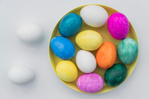Colored eggs on tray