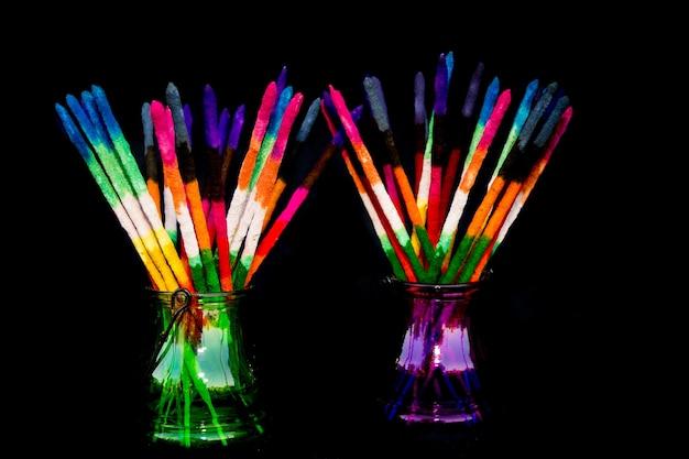 Colored and fragrance handmade incense sticks on black