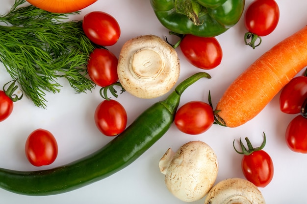 Colored fresh vegetables on white background
