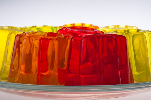 Colored fruit jelly on white background