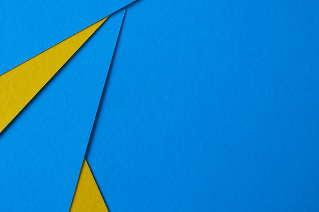 Colored geometric blue and yellow paper texture background