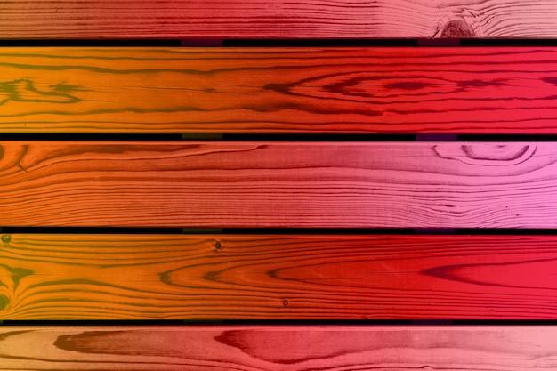 色付きのグラデーションの背景。水平木の板