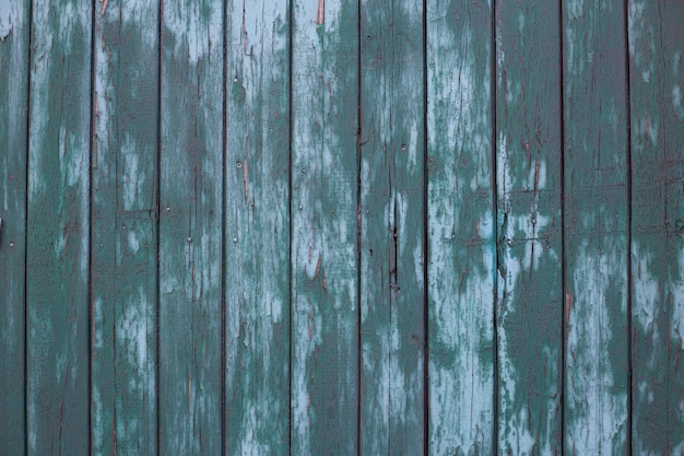 Colored in green wooden fence texture of green wooden planks old barn wall rustic style