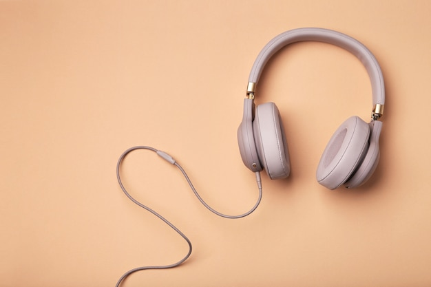 Colored headphones on a colored vintage background