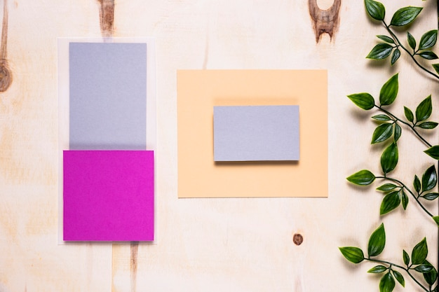 Colored invitations on wood background