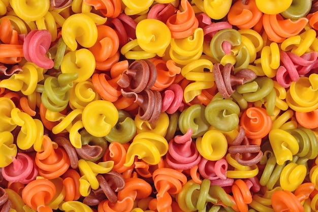 Colored italian pasta as background texture
