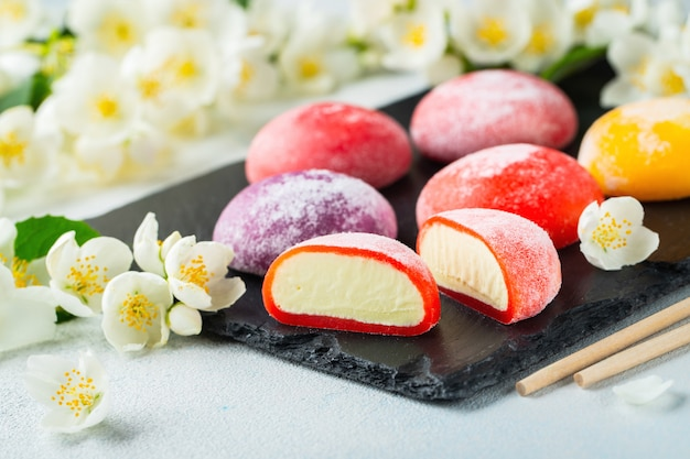 Colored japanese ice cream mochi in rice dough.
