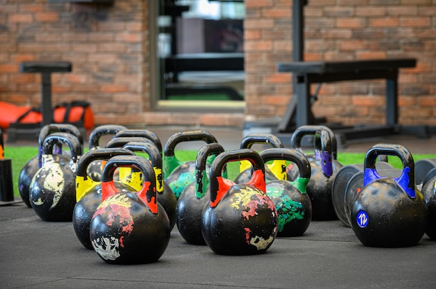 Colored kettle bells in gym