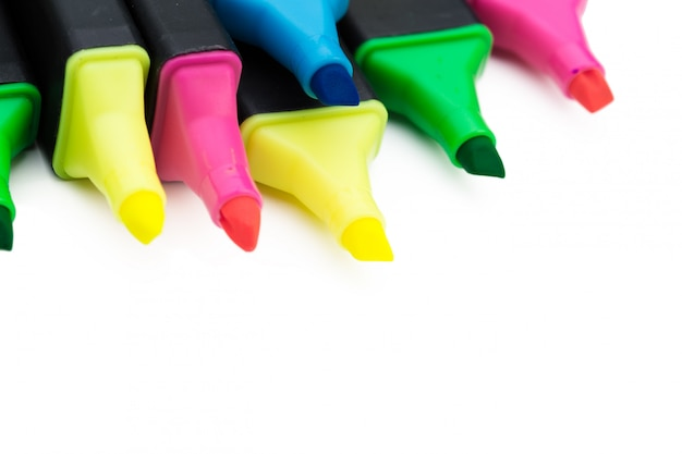 Colored markers isolated on white background close up