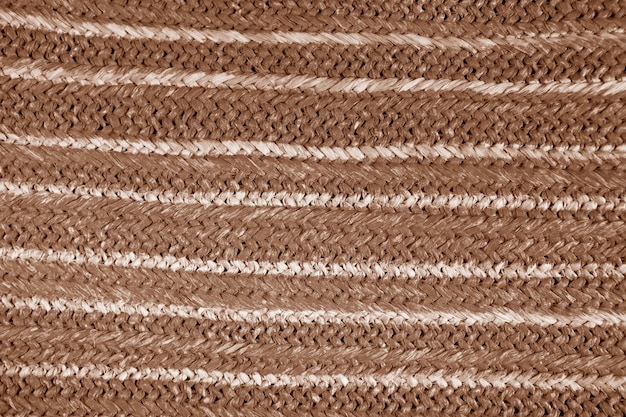 Colored natural straw texture background. wicker handbag woven straw. hemp pattern from a bag. weave pattern detail, grunge texture. wicker rough straw background closeup