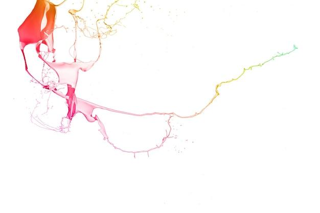 白い背景で隔離の色のペンキのはね