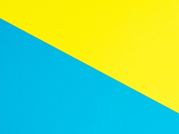 黄色と青の色紙の背景。上面図