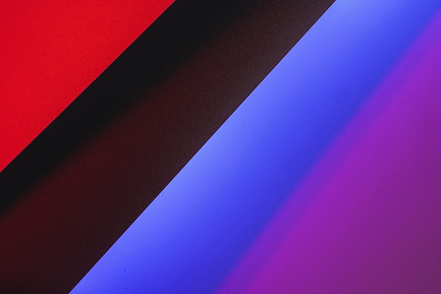 Colored paper cards in neon light, abstract background