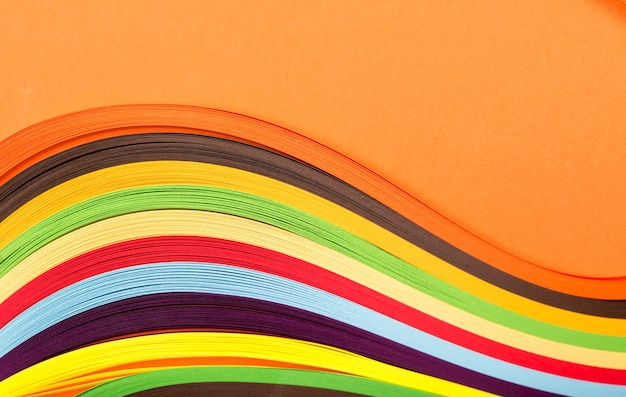 Colored paper, cross section, background stacked in wedges.