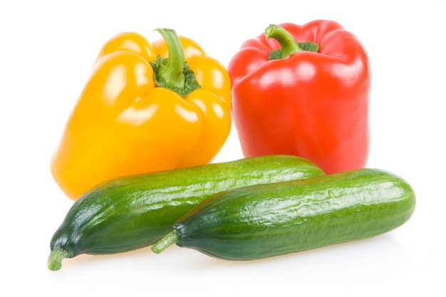 Colored paprika and cucumber vegetables isolated on white background
