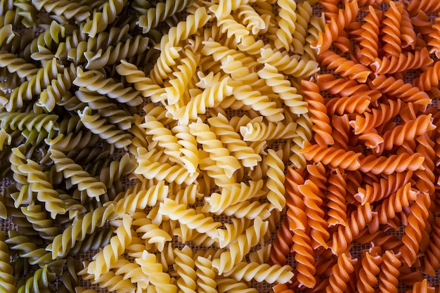 Colored pasta in shape of spirals in form of an italian flag