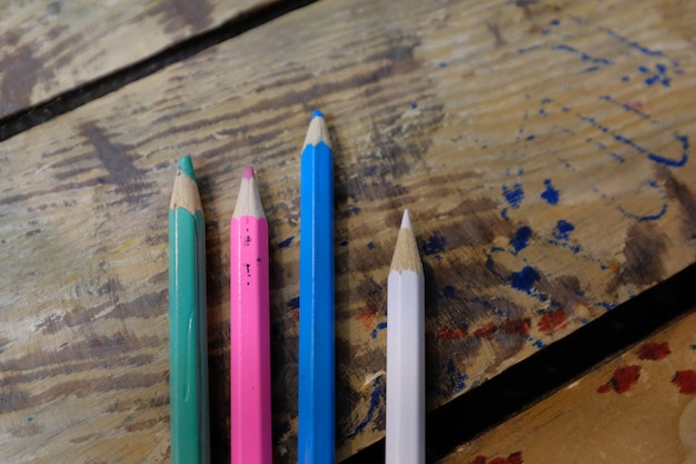 Colored pencils are on a wooden table. school of drawing, children's creativity.