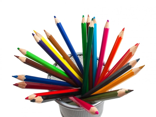 Colored pencils in basket isolated on a white  background