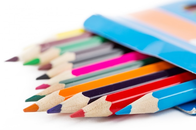 Colored pencils in box shot with selective focus