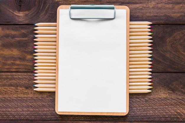 Colored pencils under clipboard