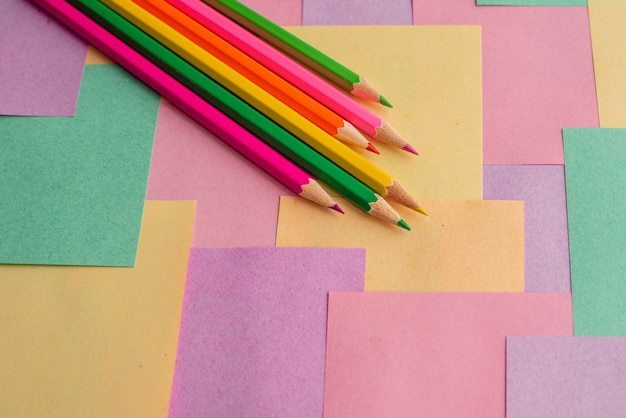 Colored pencils on detachable leaflets for notes