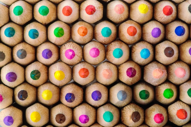 Colored pencils for drawing abstract pattern close-up top view background image