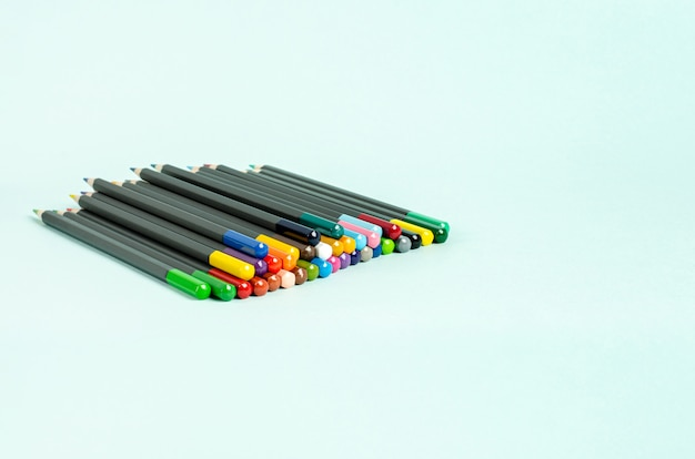 Colored pencils for drawing on a gray background