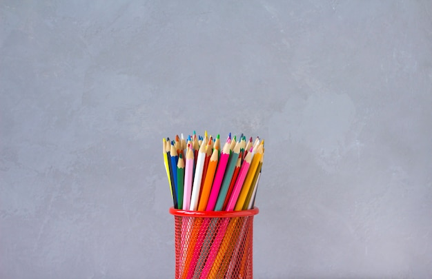 Colored pencils gray background