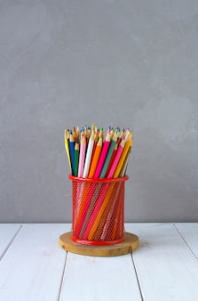 Colored pencils grey background