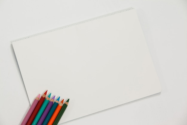 Colored pencils and notebook