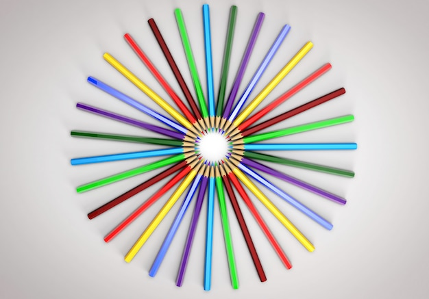 Colored pencils spread out in a circle. all colors of the rainbow.