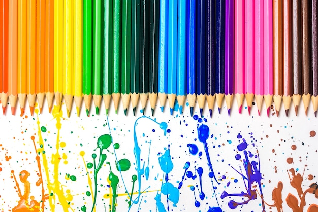 Colored pencils of various colors, color background.