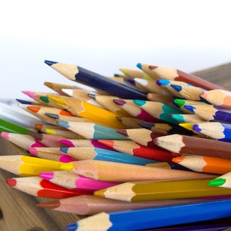 Colored pencils in a wooden box