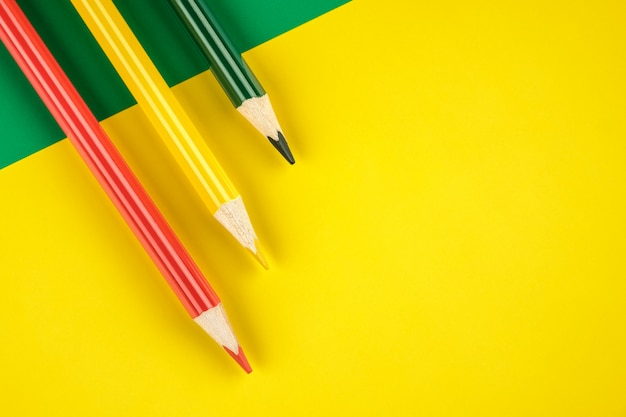 Colored pencils on yellow background
