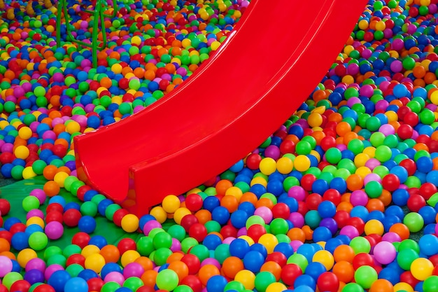 Colored plastic balls in the pool of the game room swimming pool for entertainment with colored