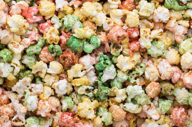 Цветной фон текстуры попкорна. сладкий попкорн.