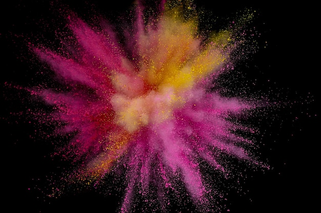 着色粉末爆発。背景に抽象的なクローズアップのほこり。カラフルな爆発。ホーリーを描く
