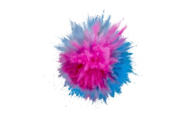 Взрыв цветного порошка на белом фоне. абстрактная пыль крупным планом на фоне. красочный взрыв. краска холи