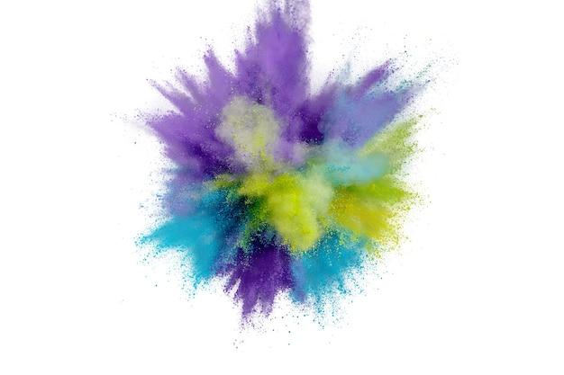 Взрыв цветного порошка на белом фоне абстрактная пыль крупным планом на фоне
