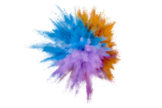 Colored powder explosion on white background. abstract closeup dust on backdrop. colorful explode. paint holi