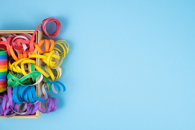 Colored ribbons on blue background. colorful spirals lgbtqia culture.