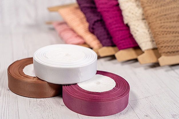 Colored ribbons and lace in coils for hobbies embroidery
